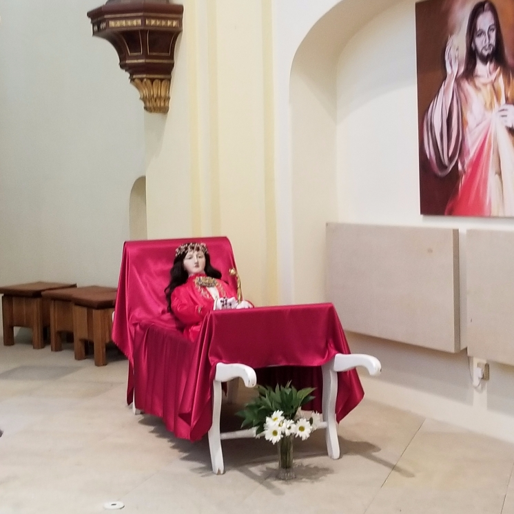 This statue of St. Philomena is displayed on a bed and is carried in a procession through the town once per year. The large jeweled thing on her chest is a reliquary.