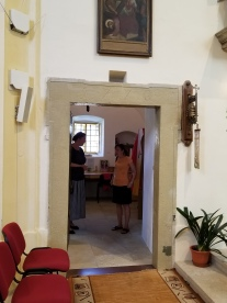 """Door to the sacristy, the lintel is inscribed """"1770."""" Hana and Jana visible."""